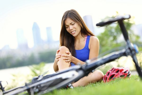 woman in pain with bike injury